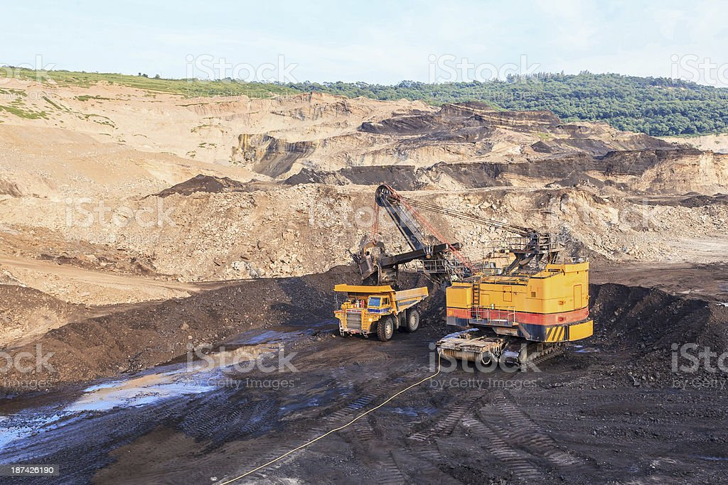 Truck and Electric Shovel in Open Pit North of THAILAND stock photo