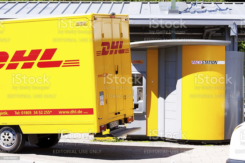 DHL truck and package station stock photo