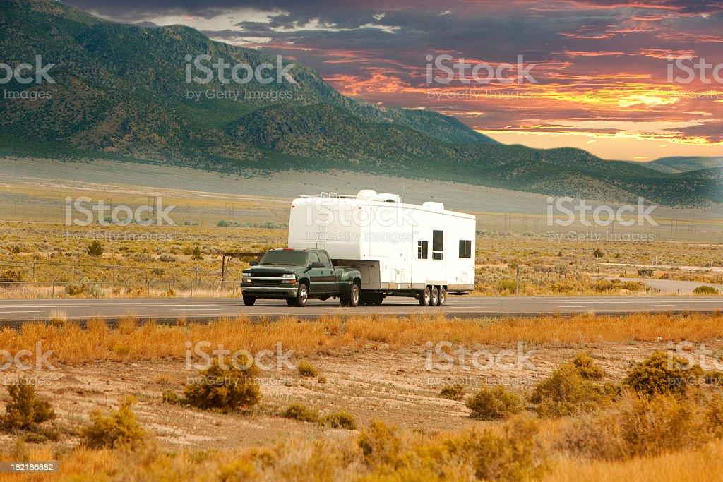 Truck and RV driving down road stock photo