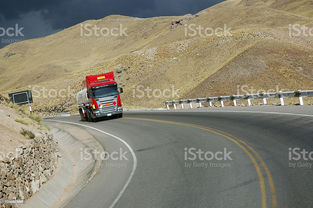 Truck at highway in cloudy weather royalty-free stock photo