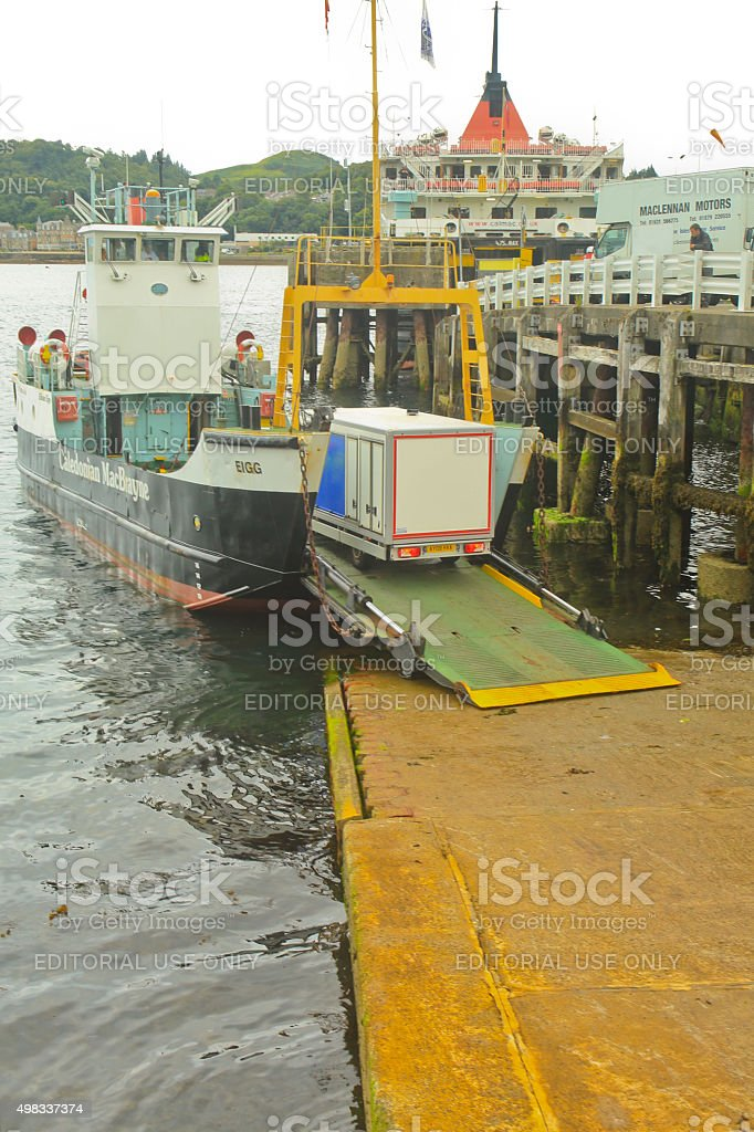 Truck Being Loaded onto Truck Ferry stock photo