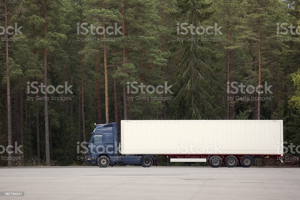 Truck by forest stock photo