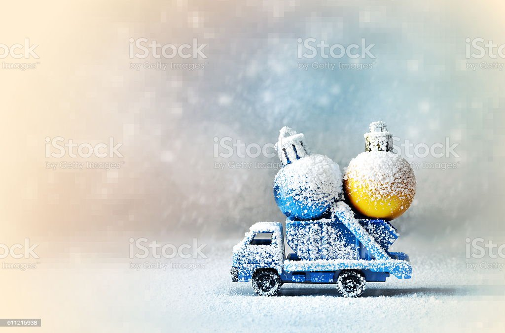 Truck car carries Cristmas ball for Christmas trees. stock photo