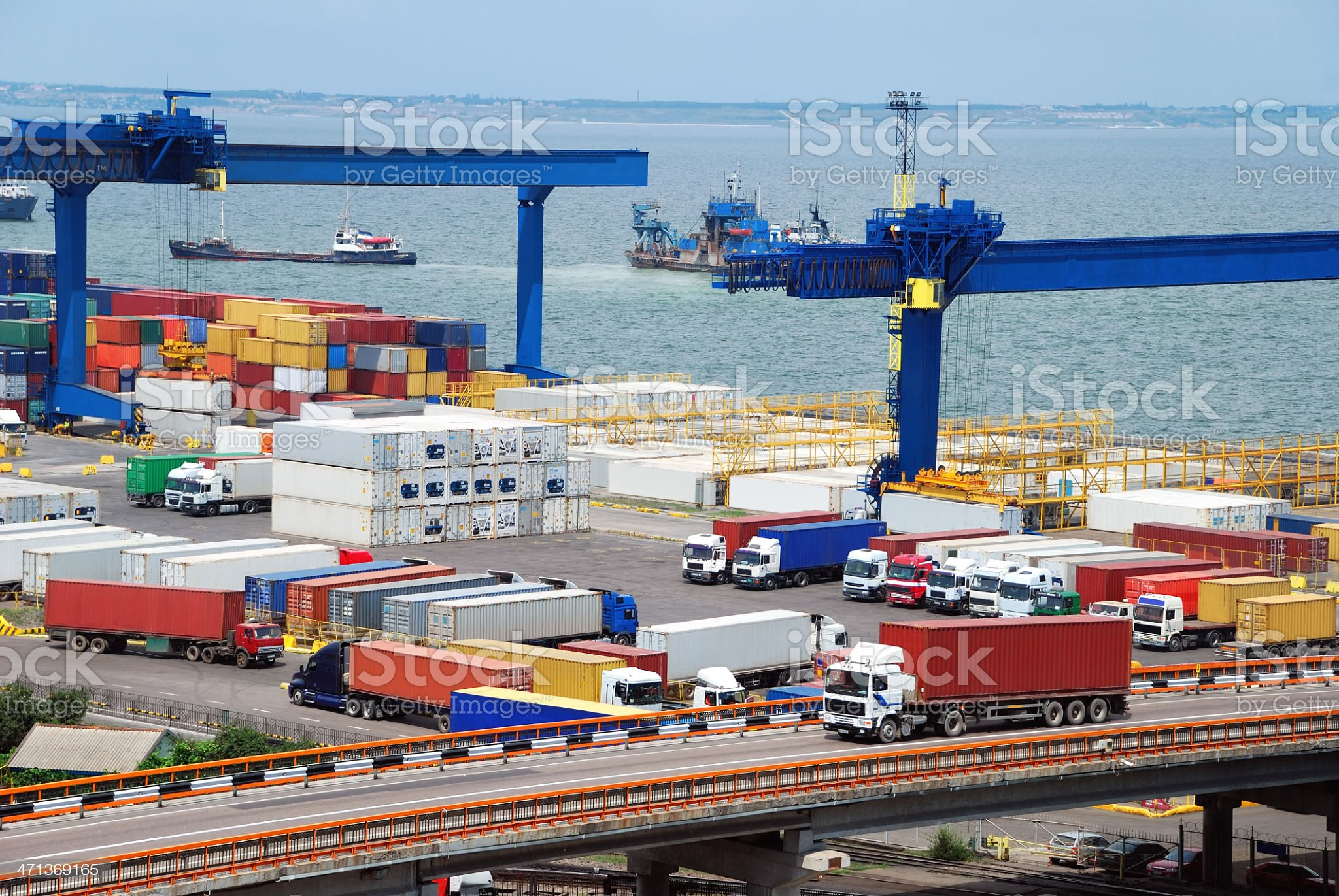 truck carries container to warehouse near sea royalty-free stock photo