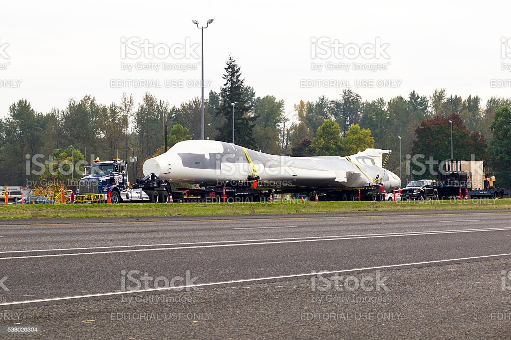 Truck Carring B-1 Bomber with Oversize Load Sign I-5 Oregon stock photo