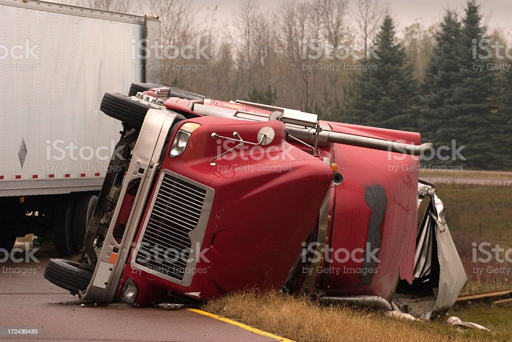 Truck crash with turned over semi stock photo