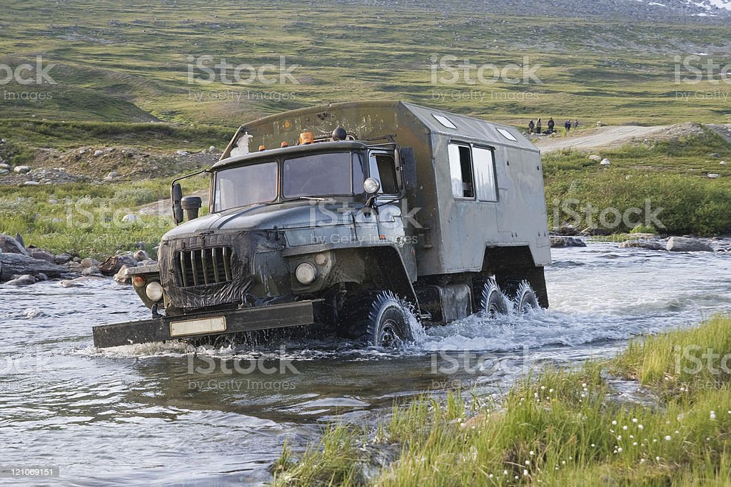 Truck crossing a river stock photo