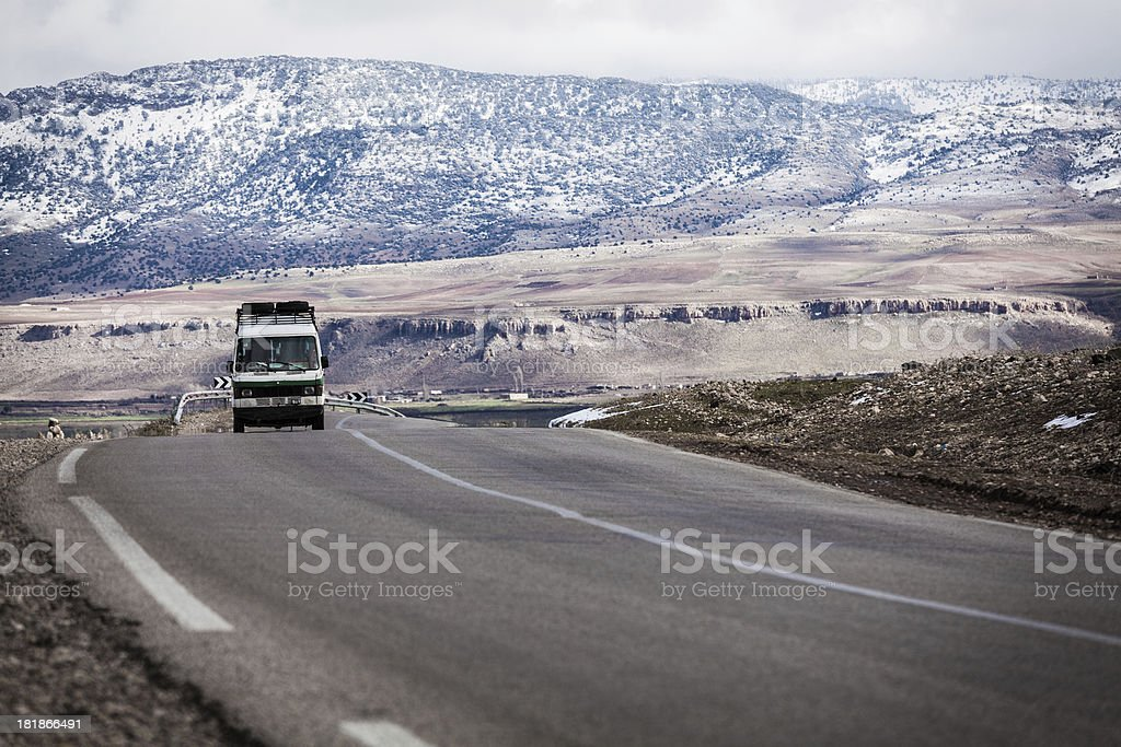 Truck Crossing the Atlas Mountains in Morocco royalty-free stock photo