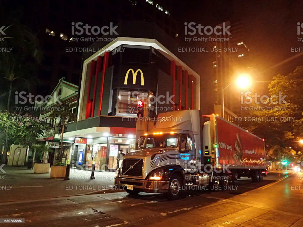 Truck Delivers food to McDonalds Store in Downtown stock photo