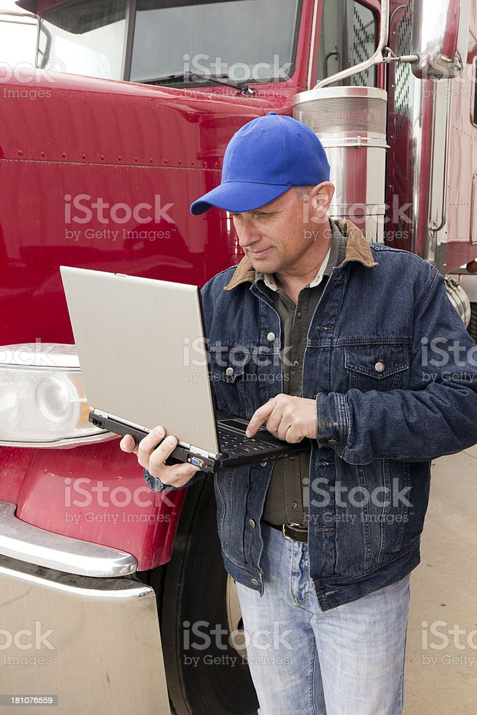 Truck Driver and Computer royalty-free stock photo
