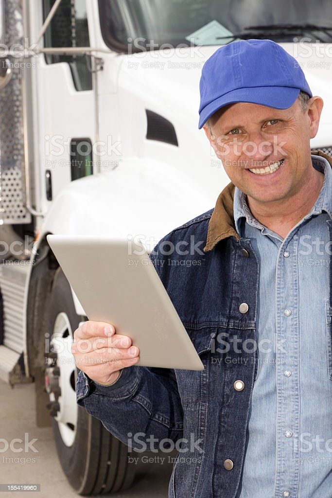 Truck Driver and Tablet PC royalty-free stock photo