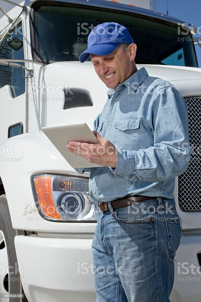 Truck Driver and Tablet PC stock photo