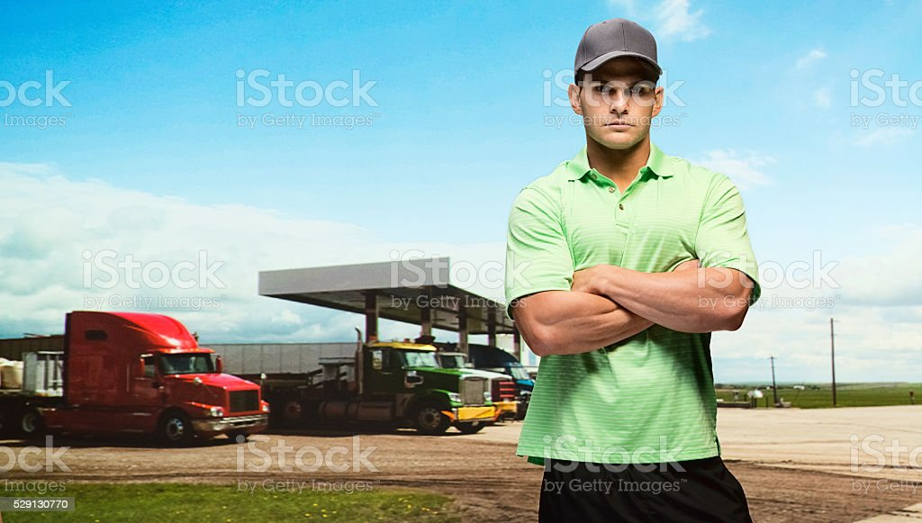 Truck driver at the gas station stock photo