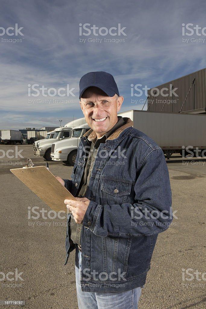 Truck Driver at Warehouse royalty-free stock photo