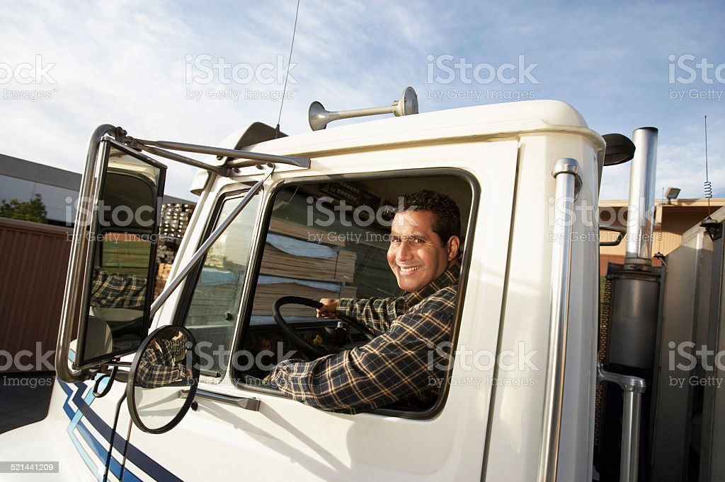Truck Driver Behind the Wheel stock photo