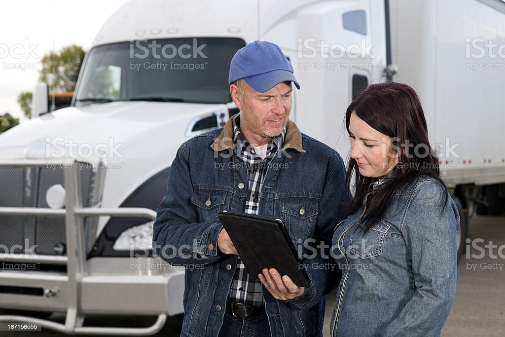Truck Driver Couple and Computer royalty-free stock photo
