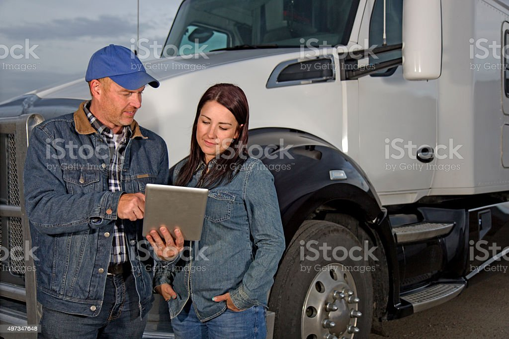 Truck Driver Couple and Computer stock photo