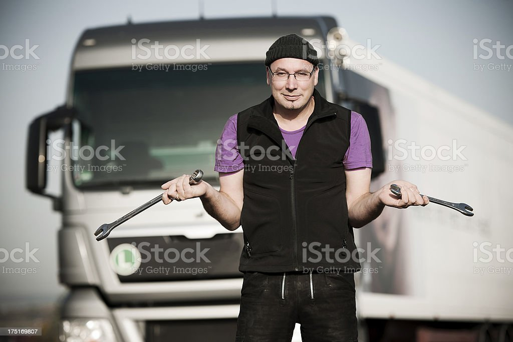 Truck driver holding tools royalty-free stock photo