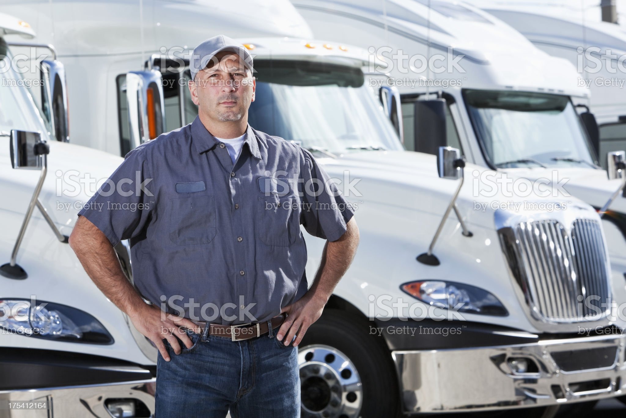Truck driver standing in front of big rigs royalty-free stock photo
