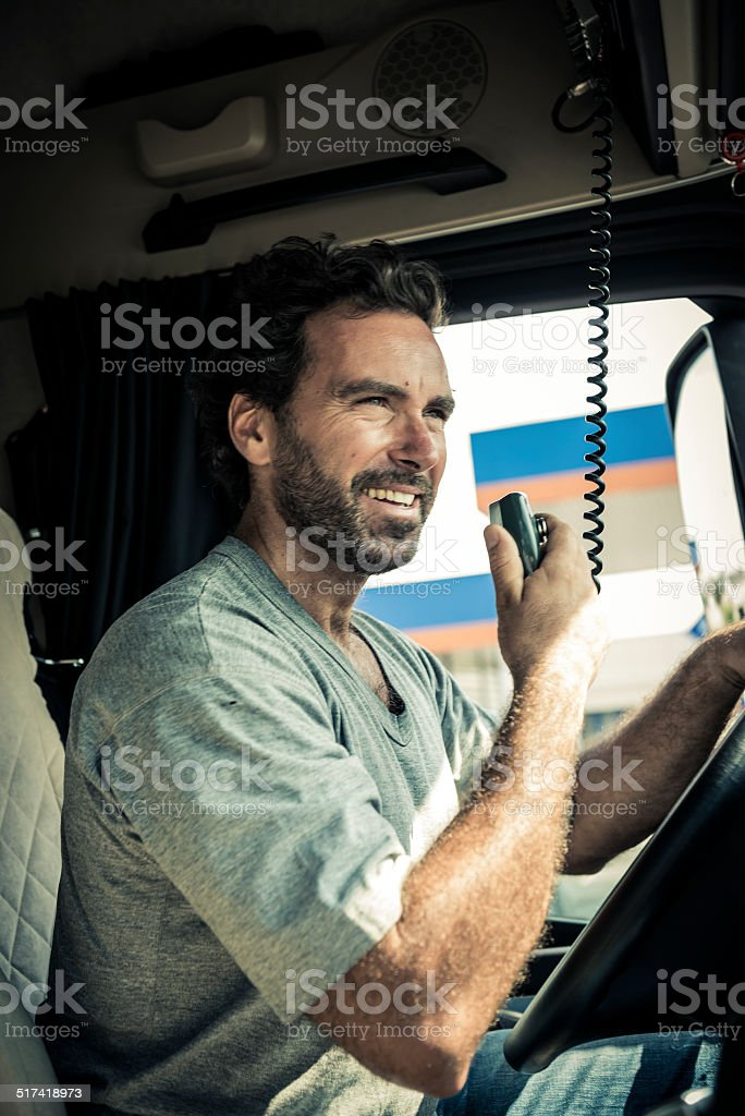Truck Driver Using His CB Radio stock photo