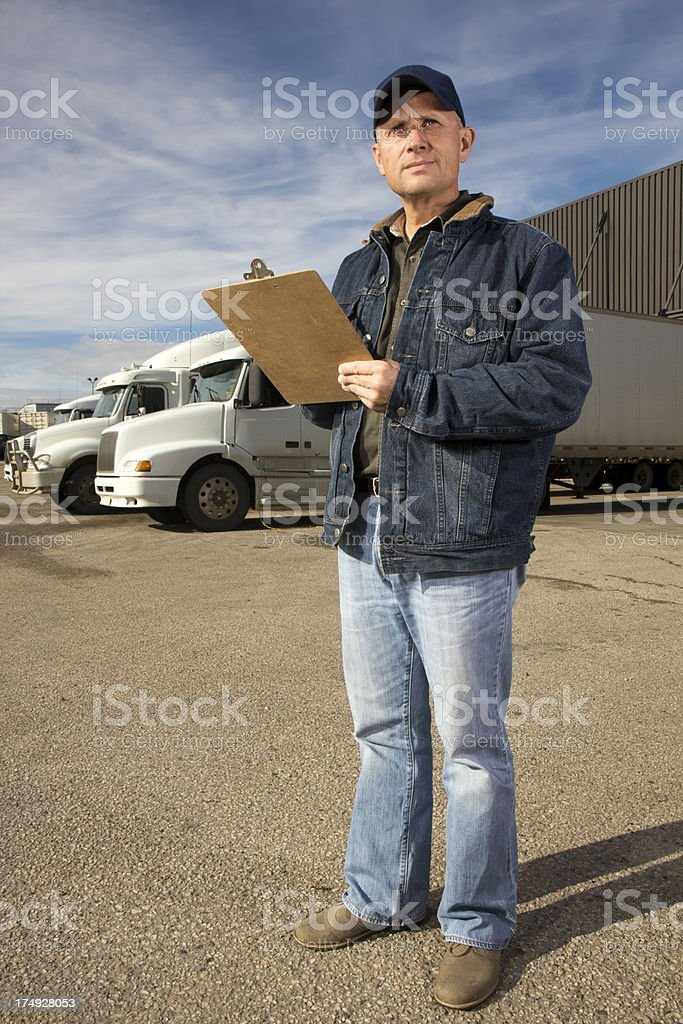 Truck Driver, Warehouse and Clipboard royalty-free stock photo