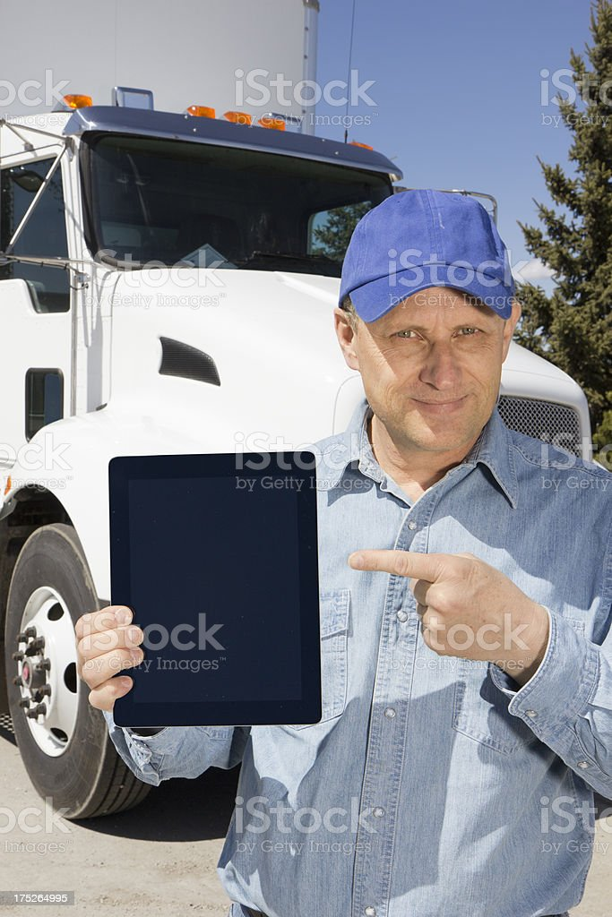 Truck Driver with Tablet Computer royalty-free stock photo