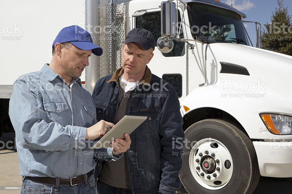 Truck Drivers and Computer royalty-free stock photo