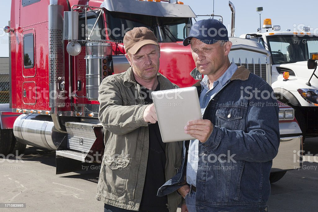 Truck Drivers and Tablet PC royalty-free stock photo