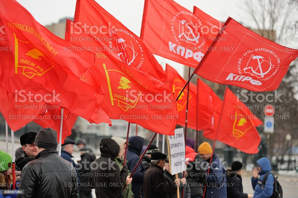 Truck drivers picket. Crowd of people with red communist flags stock photo