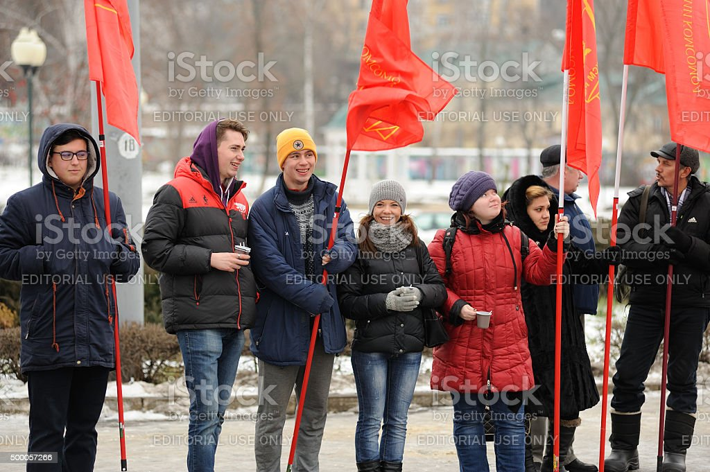 Truck drivers picket. Girls and boys with red flags stock photo