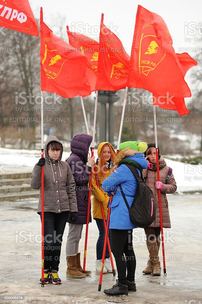 Truck drivers picket. Young girls with red communist flags stock photo