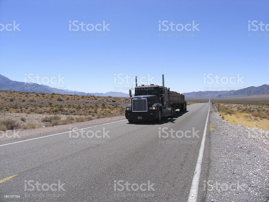 truck driving by in death valley stock photo