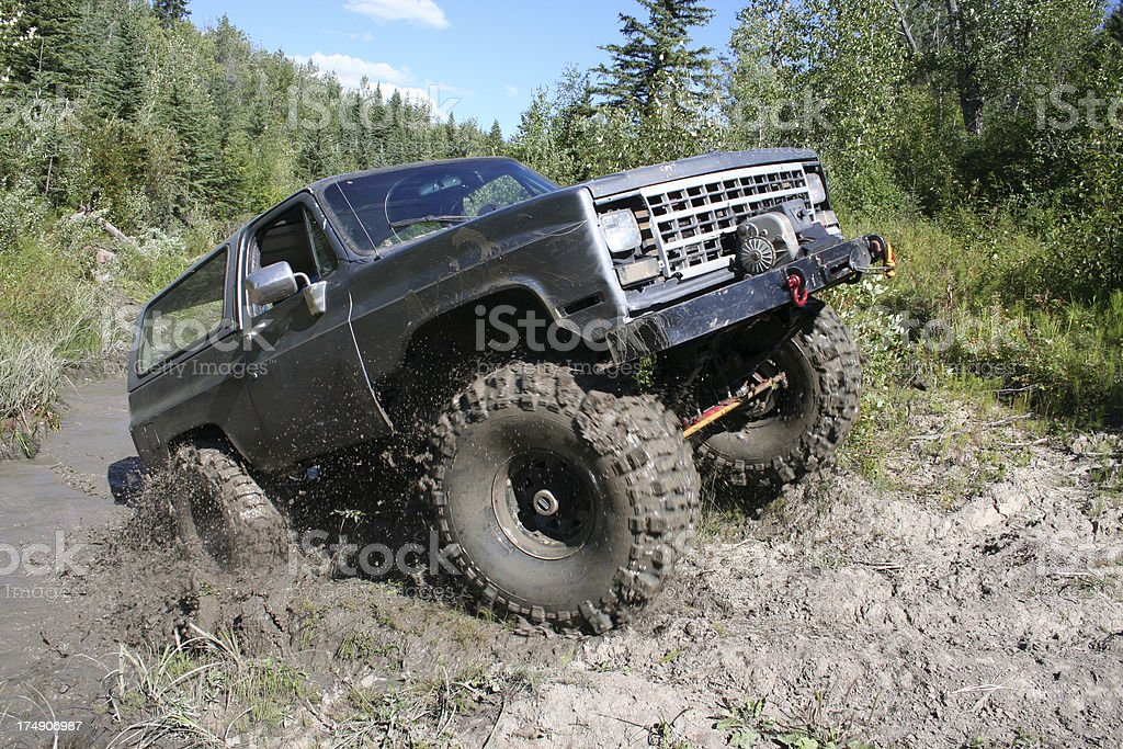 4X4 truck driving  in mud. stock photo