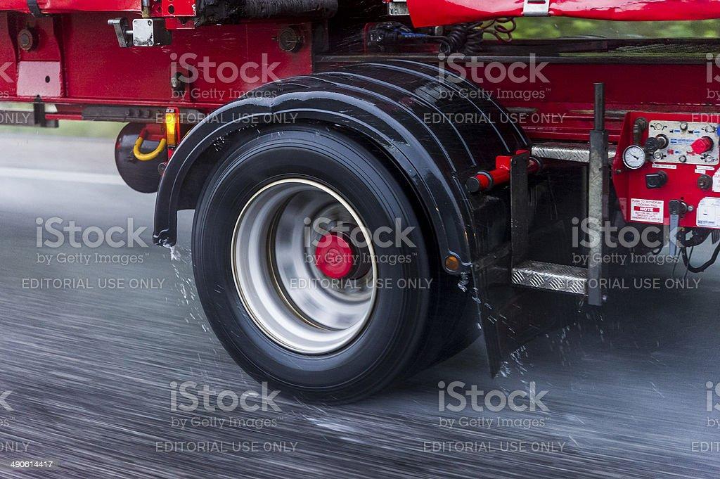 Truck driving in rain stock photo
