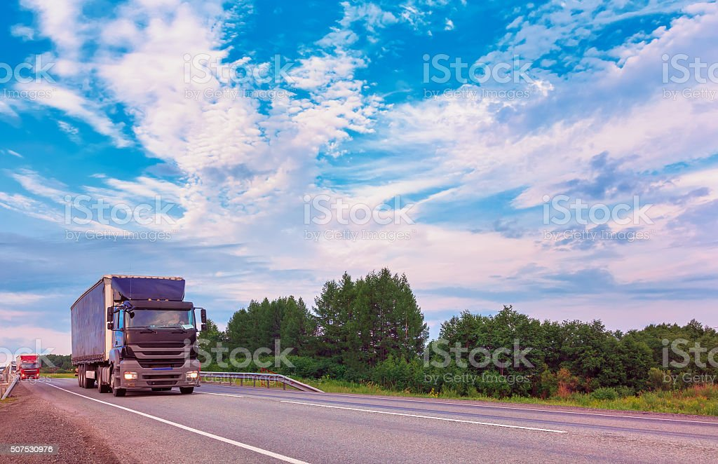 Truck driving on a road summer nature stock photo