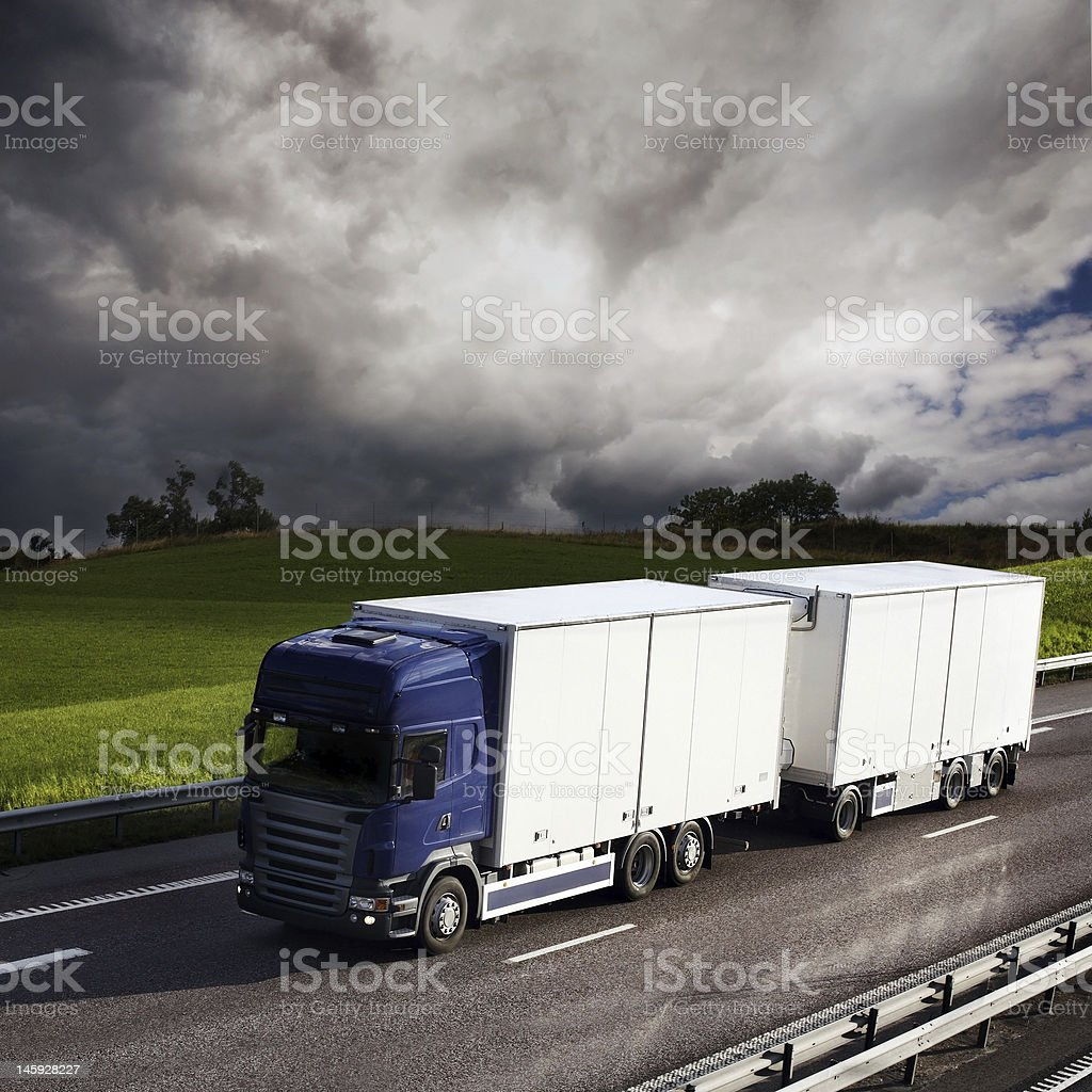 truck driving on country-road royalty-free stock photo