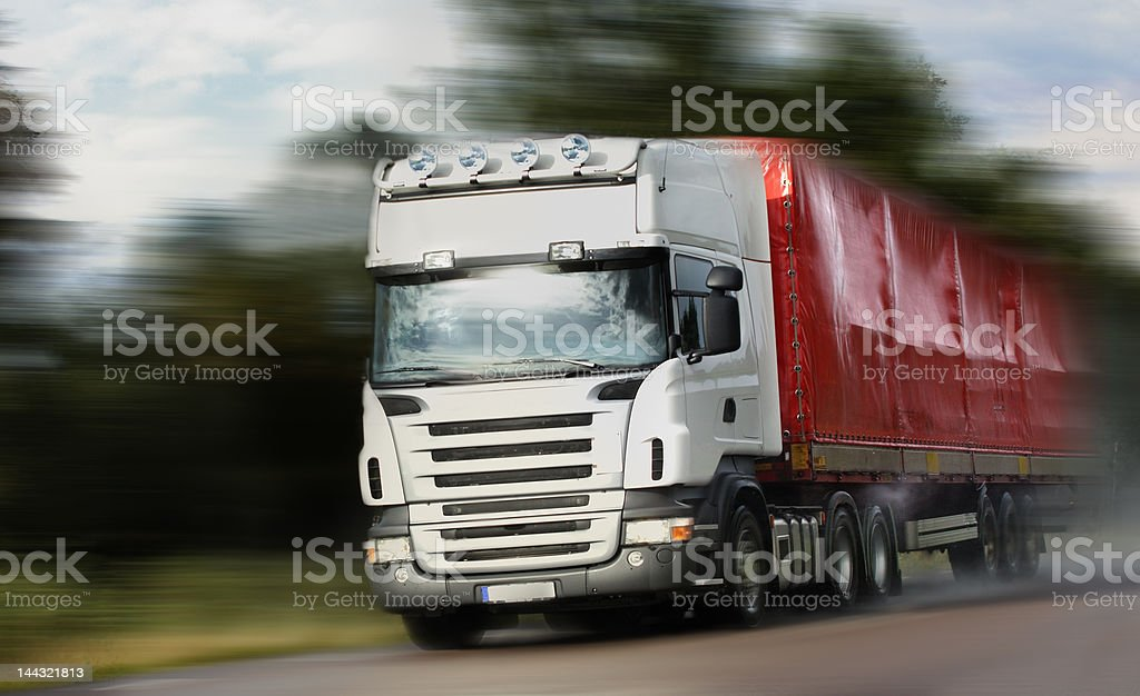 truck driving on country-road/motion royalty-free stock photo