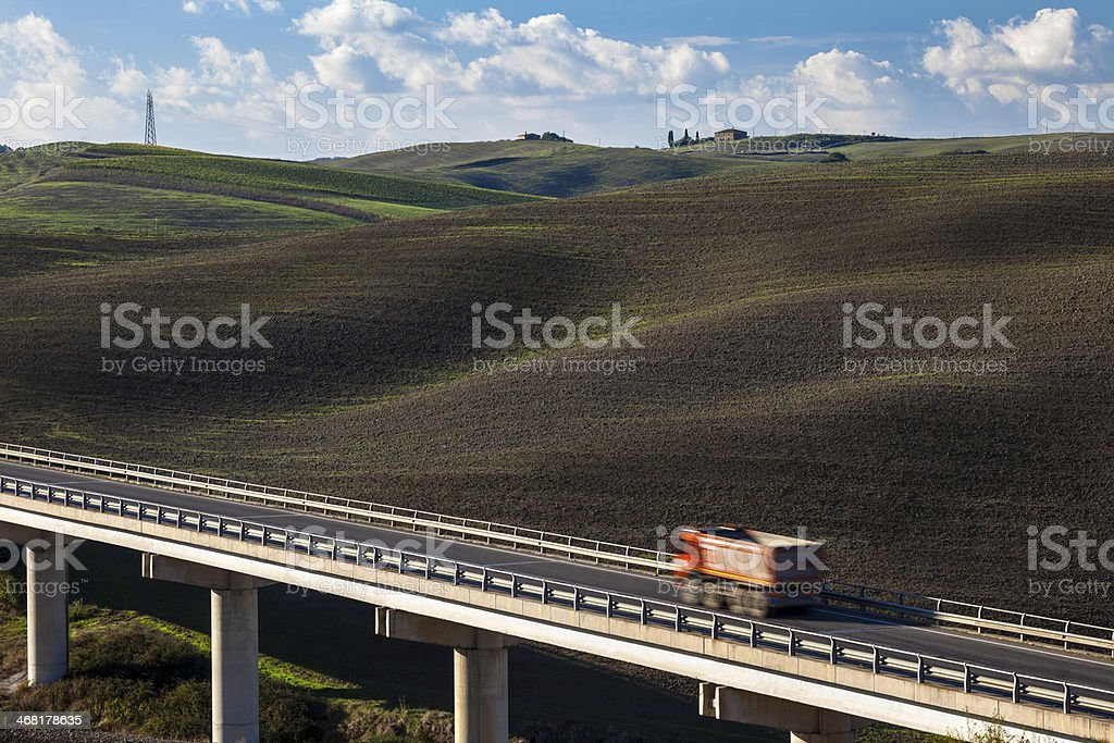 Truck Driving on Freeway Bridge in Tuscany, Italy royalty-free stock photo