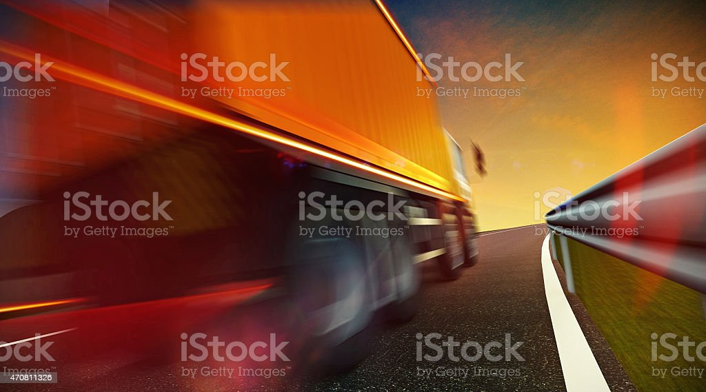 Truck driving on highway road on sunset stock photo