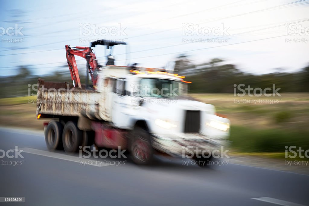 Truck driving on the highway royalty-free stock photo