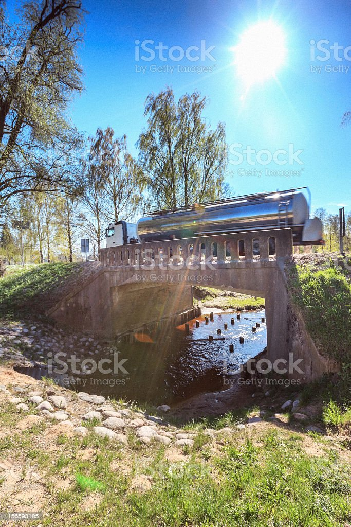 Truck driving over the bridge royalty-free stock photo