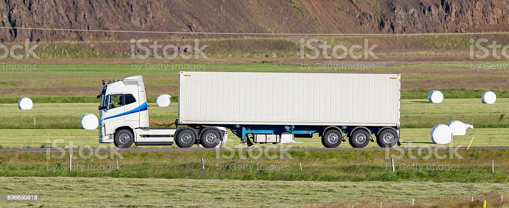 Truck driving through a rural area stock photo