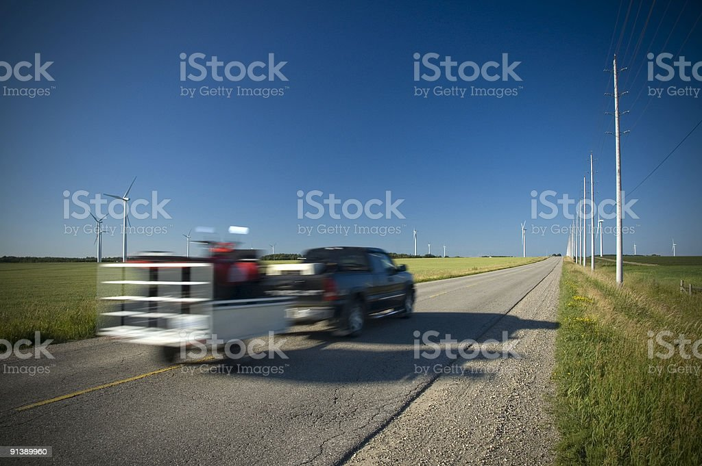 Truck driving through Ontario countryside road stock photo