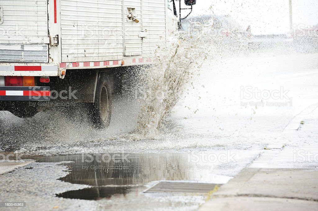 Truck driving through puddle royalty-free stock photo