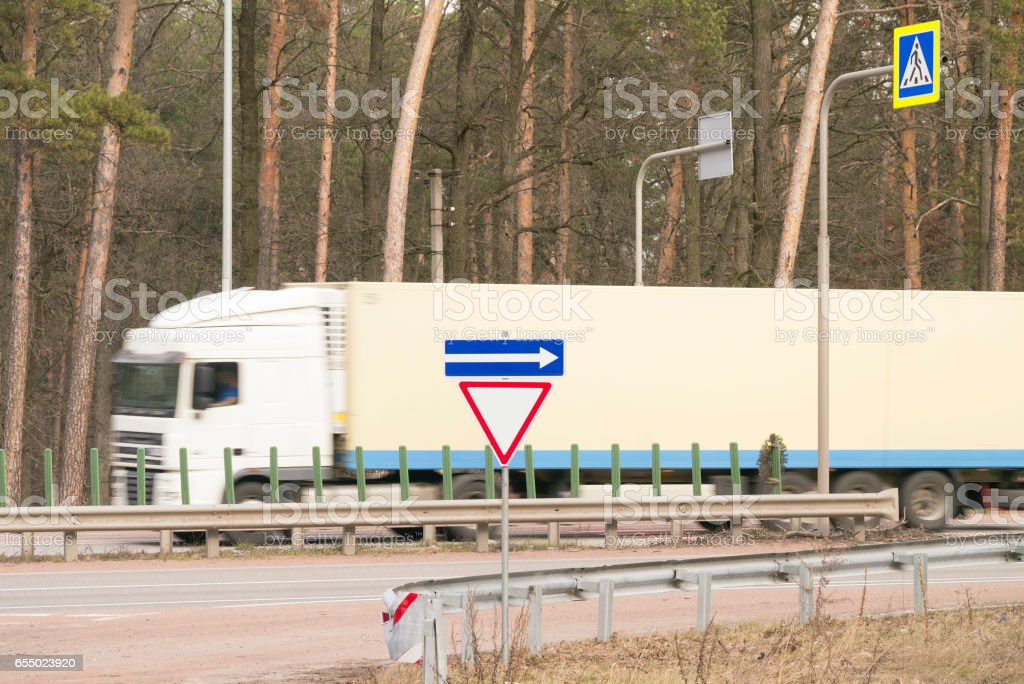 Truck fast moving on the road stock photo