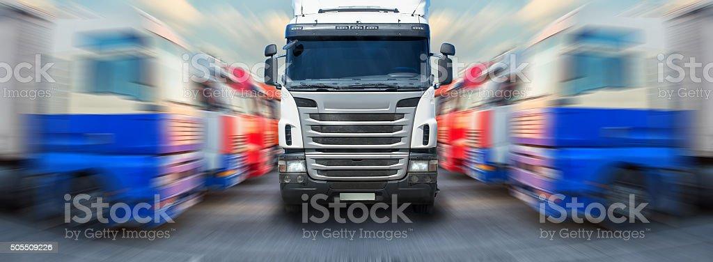 truck goes along ranks of trucks stock photo