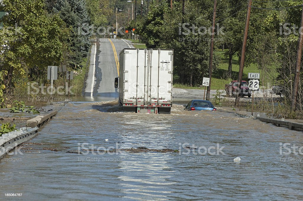 Truck Going Through Deep Flood Water Over Highway royalty-free stock photo