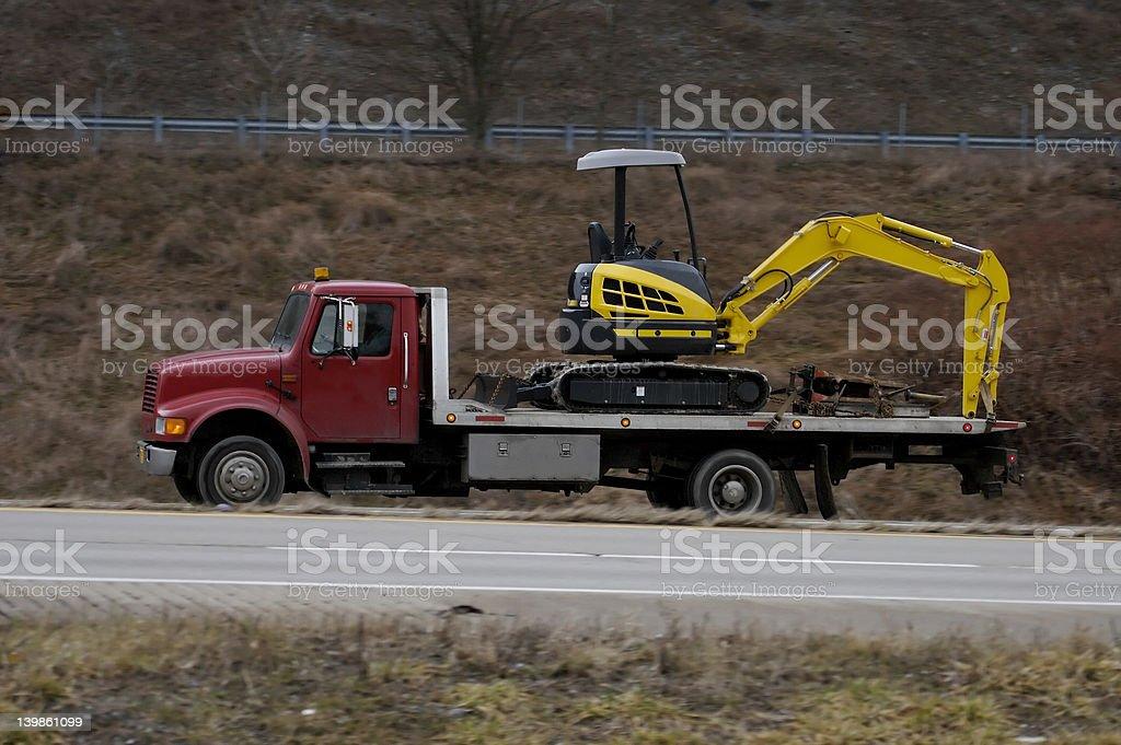Truck Hauling Backhoe royalty-free stock photo