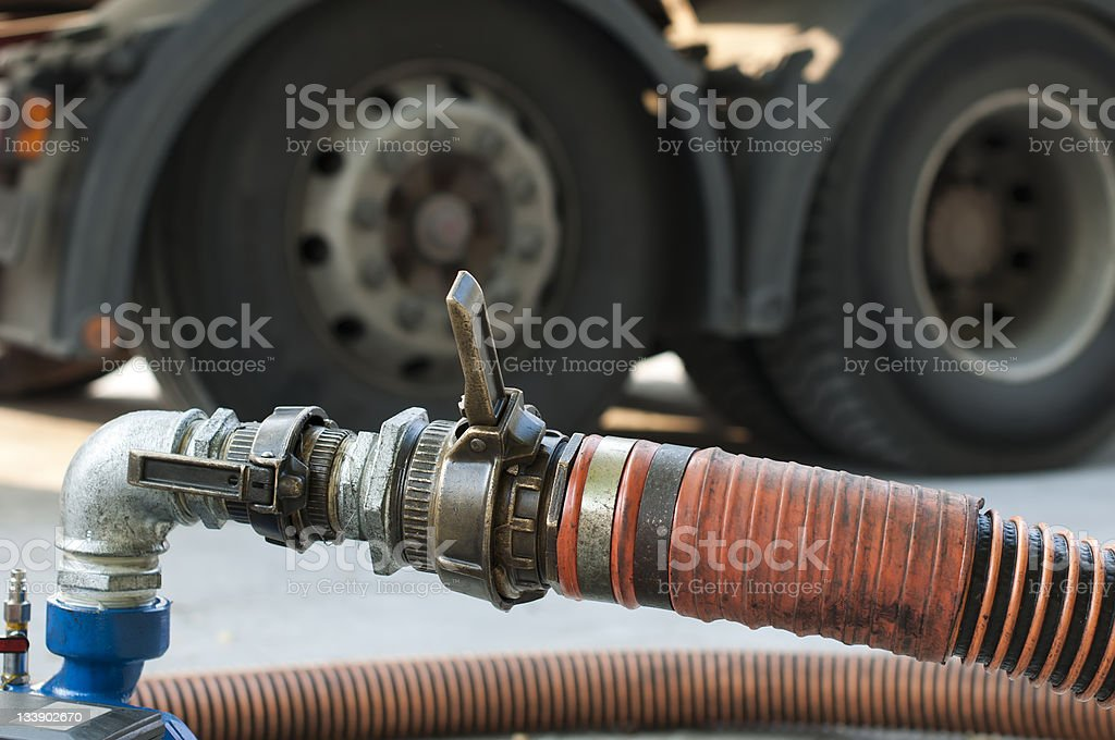 Truck Hoses for fuel station, pumps and oil barrels royalty-free stock photo