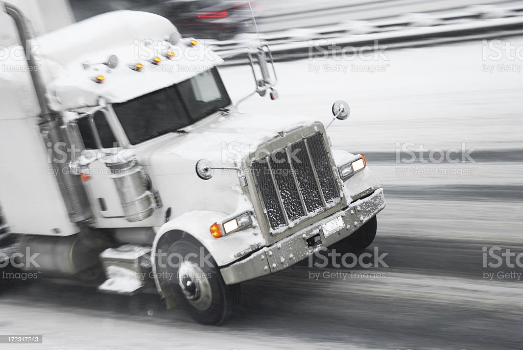 Truck in motion during a snow storm stock photo